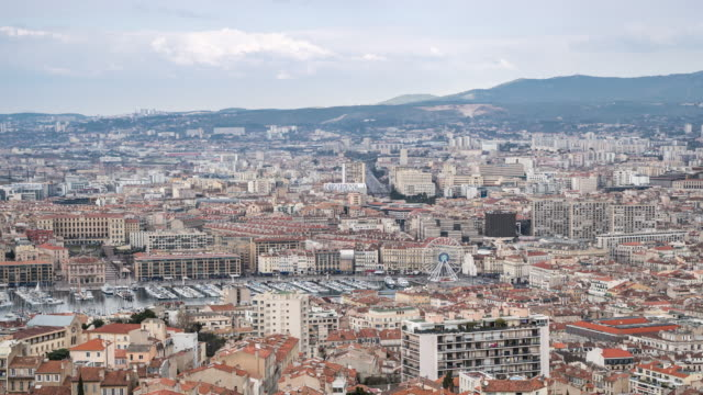 Time-lapse: Aerial Marseille city with old Vieux Port
