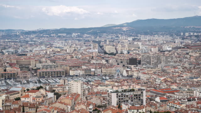 time-lapse: aerial marseille city with old vieux port - notre dame de la garde marseille stock videos and b-roll footage