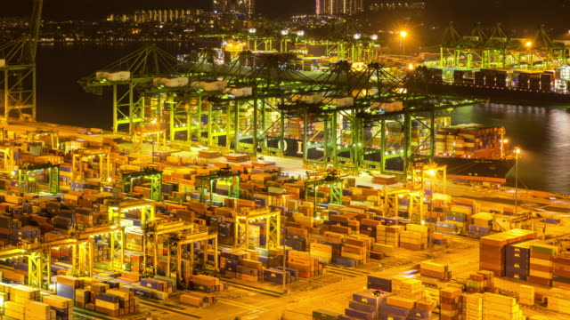 4K time-lapse: aerial shot warehouse Port background in Singapore night
