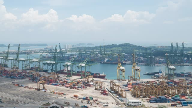 4k time-lapse: aerial shot warehouse port background in singapore - commercial land vehicle stock videos & royalty-free footage