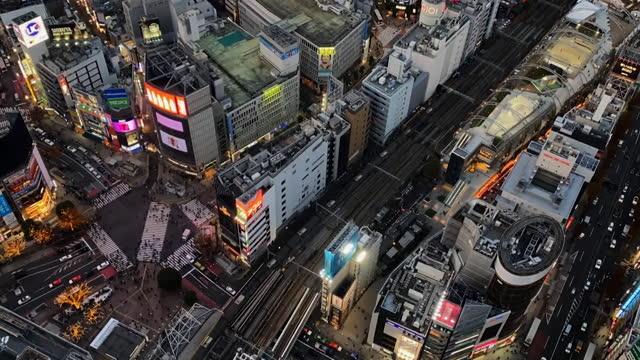 timelapse aerial tokyo street scenes at night - high street stock videos & royalty-free footage