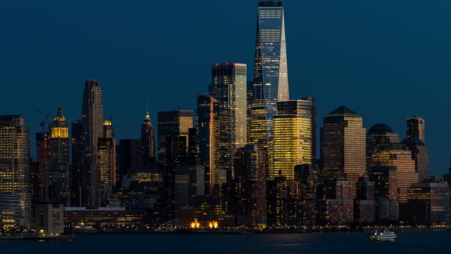 timelapse: aerial view lower manhattan with hudson river, new york city twilight sunset - street light stock videos & royalty-free footage