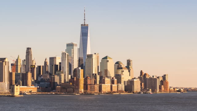 vídeos de stock e filmes b-roll de timelapse: aerial view lower manhattan with hudson river, new york city sunset - world trade center manhattan