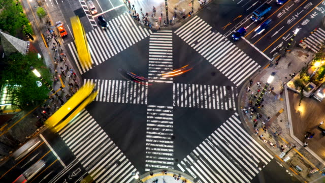 timelapse - aerial view of a crossing in ginza at night time / tokyo, japan - pedestrian crossing stock videos & royalty-free footage