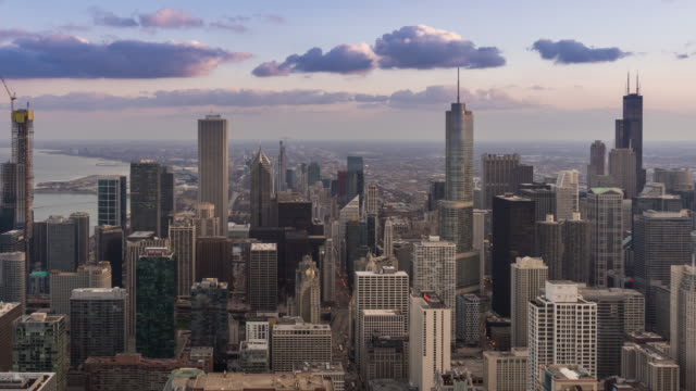 time-lapse: aerial view of chicago skyline cityscape looking south loop, il usa at sunset twilight - chicago loop stock videos and b-roll footage