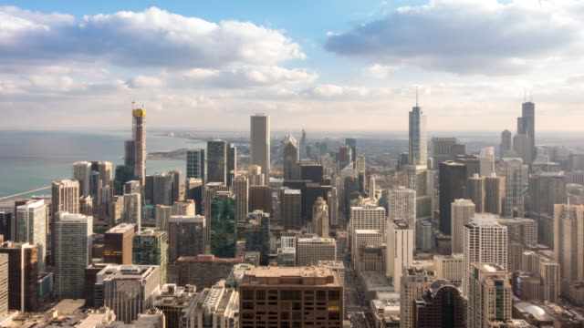 time-lapse: aerial view of chicago skyline cityscape looking south loop, il usa at sunset - chicago loop stock videos and b-roll footage