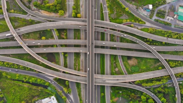 time-lapse : aerial view of expressway road intersection - urban road stock videos & royalty-free footage