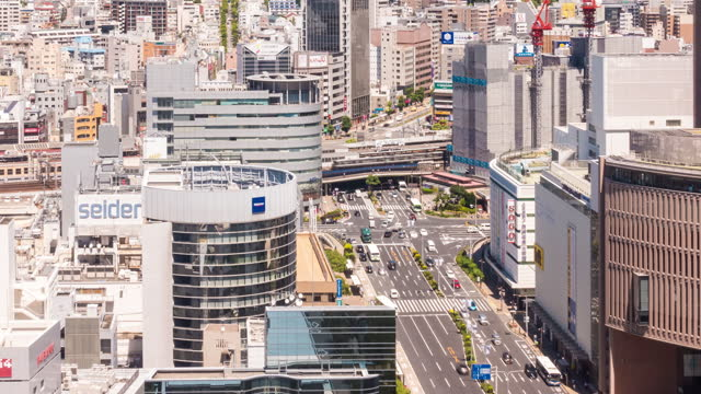 time-lapse: aerial view of kobe cityscape and train station with transportation. - elevated train stock videos & royalty-free footage