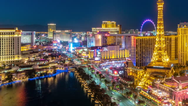 time-lapse aerial view of las vegas strip in nevada usa sunset night - casino night stock videos & royalty-free footage