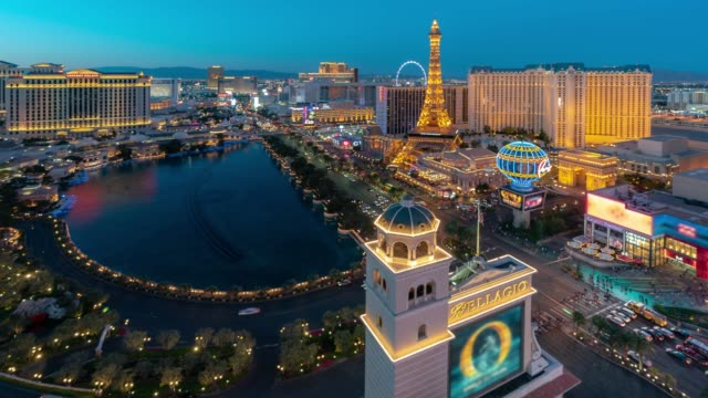 time-lapse aerial view of las vegas strip in nevada usa sunset night - casino stock videos & royalty-free footage