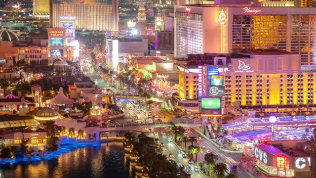 time-lapse aerial view of las vegas strip in nevada usa sunset night - las vegas stock videos & royalty-free footage