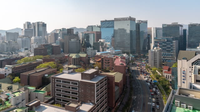 time-lapse: aerial view of myeongdong downtown skyscraper skyline in seoul south korea - south korea stock videos and b-roll footage
