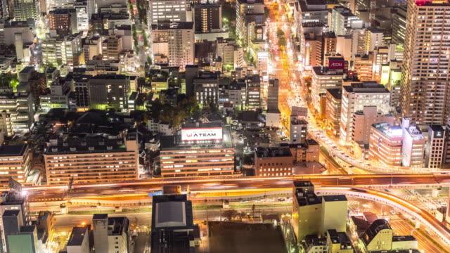 夜日本で名古屋都市高速道路の時間経過: 空撮 - 列車の車両点の映像素材/bロール