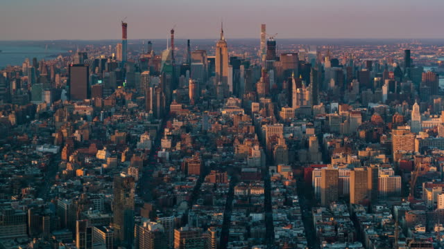 time-lapse: aerial view of new york city skyline mid town sunset twilight - aerial view stock videos & royalty-free footage