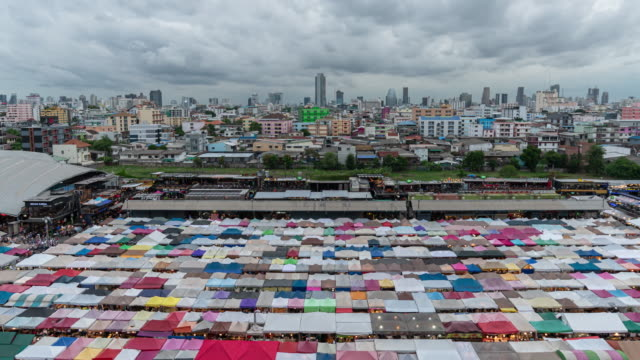 time-lapse : aerial view of night market in bangkok, thailand - street market stock videos & royalty-free footage