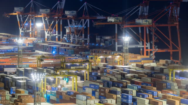time-lapse: aerial view of port working cargo container in odaiba tokyo japan at night - container stock videos & royalty-free footage