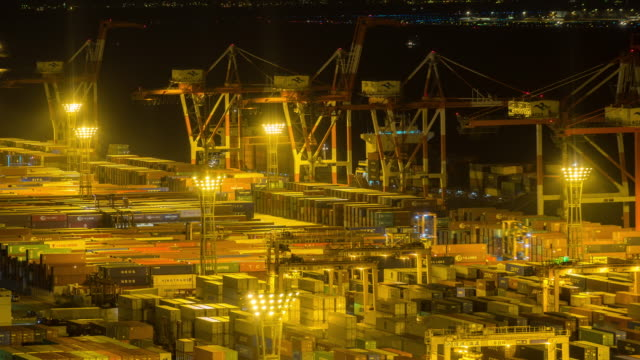 Time-lapse: aerial view of Port Working Cargo Container in Odaiba Tokyo Japan at night