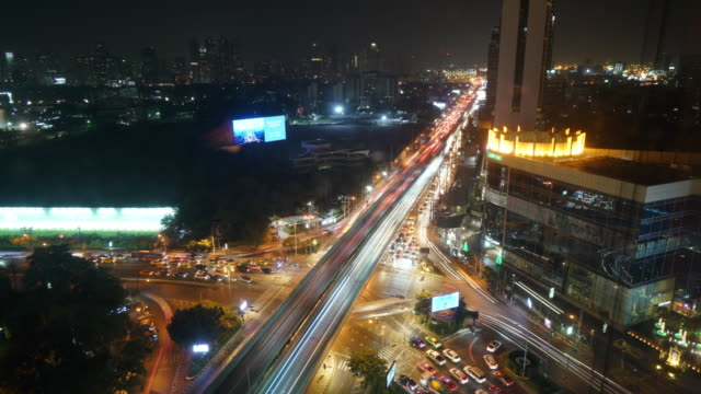 timelapse aerial view of rush hour traffic on expressway - population explosion stock videos and b-roll footage