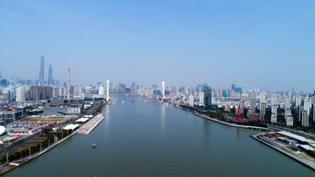 Timelapse - aerial view of Shanghai Huangpu River; the tall buildings are Lujiazui business center.