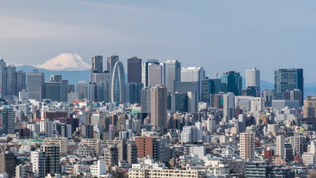 time-lapse: aerial view of shinjuku tokyo cityscape with mountain fuji - mt fuji stock videos & royalty-free footage