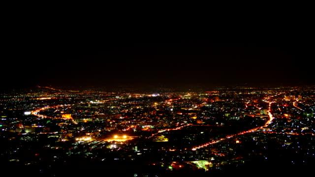 vídeos de stock, filmes e b-roll de intervalo de tempo: vista aérea de pequena cidade à noite - aldeia