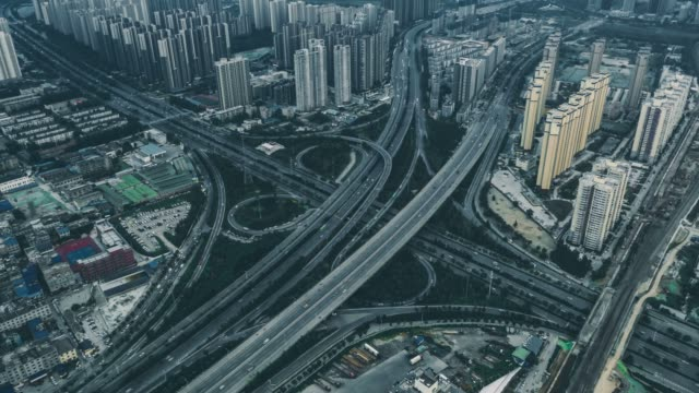 timelapse aerial view of traffic on overpass - motorway stock videos & royalty-free footage