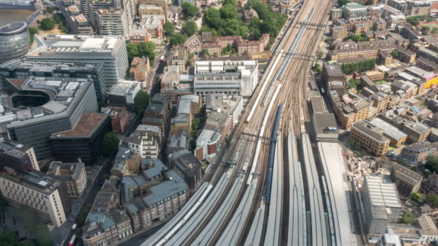 time-lapse aerial view of train arrival and departure in london england uk - railway station stock videos & royalty-free footage