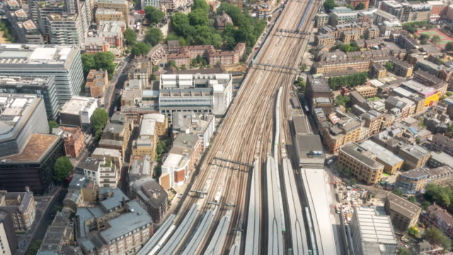 time-lapse aerial view of train arrival and departure in london england uk - train vehicle stock videos & royalty-free footage