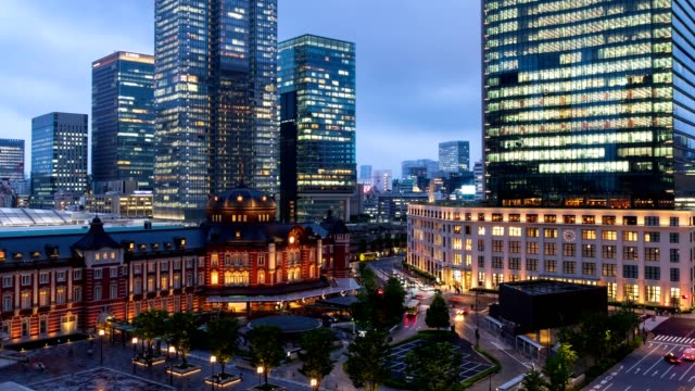 4k time-lapse : aerial view of traveler pedestrian crowd at front of tokyo station at twilight, tokyo, japan. tilt down shot - marunouchi stock videos & royalty-free footage
