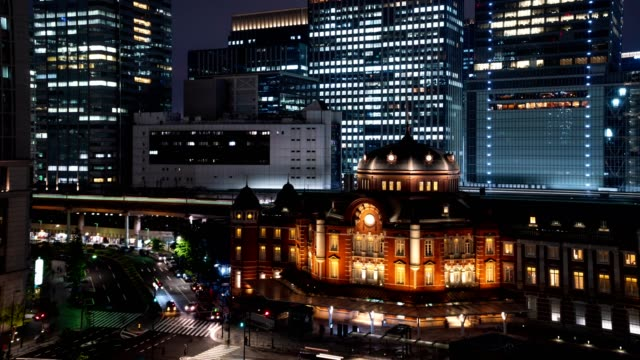 4k time-lapse : aerial view of traveler pedestrian crowd at front of tokyo station at twilight, tokyo, japan. - marunouchi stock videos & royalty-free footage