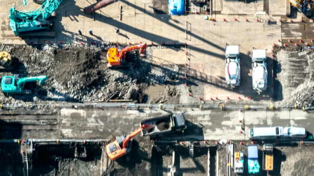 hd time-lapse: aerial view of working construction site - construction site stock videos and b-roll footage