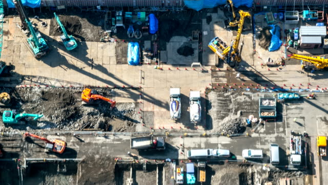 hd time-lapse: aerial view of working construction site - construction site stock videos & royalty-free footage