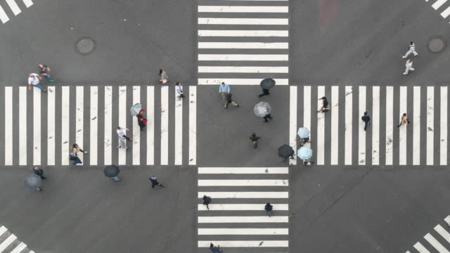 time-lapse: aerial view pedestrians cross at ginza crossing tokyo japan - pedestrian stock videos & royalty-free footage