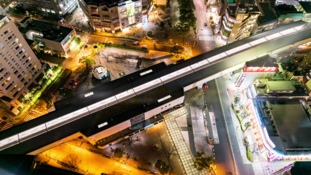 time-lapse: aerial view tokyo cityscape with japan rail subway metro at night - railway station platform stock videos & royalty-free footage
