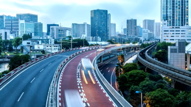 4K Time-lapse, aerial view Tokyo skyline cityscape with highway and buildings from sunset to night, Tennoz Isle area, Tokyo, Japan.