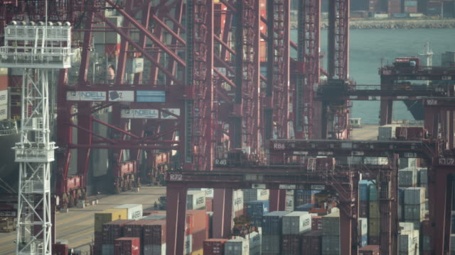time-lapse: aerial view unloading of cargo from trolley freight truck to cargo ship at hong kong maritime container port tsing yi - heavy goods vehicle stock videos & royalty-free footage