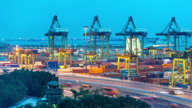 4K time-lapse: aerial warehouse Port background in Singapore at dusk
