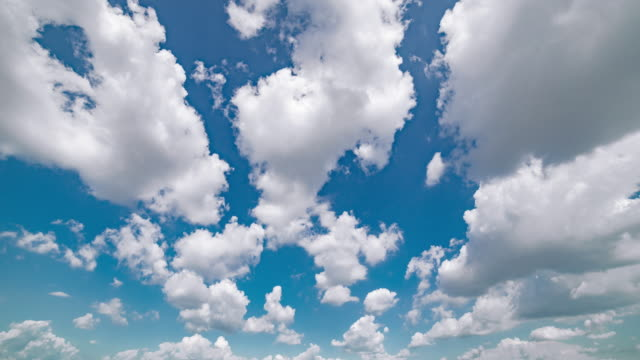 timelapse aerial wide shot of clouds movinf over blue sky - wide stock videos & royalty-free footage