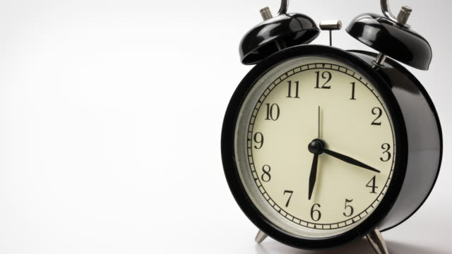 time-lapse : alarm clock motion shows passing time, 4k resolution. - single object stock videos & royalty-free footage