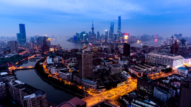 timelapse and aerial view of the skyline of shanghai, china - distrust stock videos & royalty-free footage