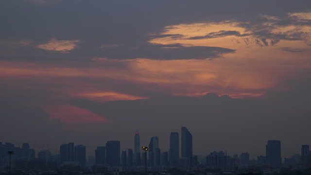 time-lapse and tilt down: sunset of cityscapes in bangkok, thailand. - sunset to night time lapse stock videos & royalty-free footage