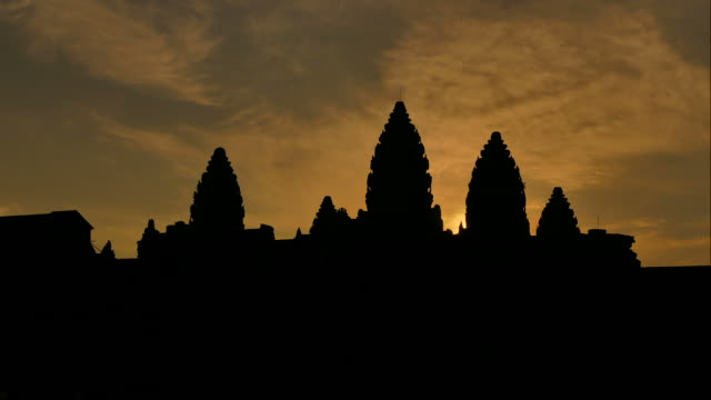 time-lapse: angkor wat temple at sunrise silhouette - circa 13th century stock videos & royalty-free footage