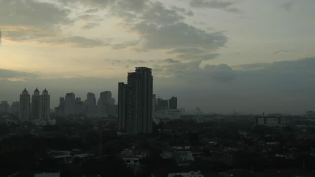 timelapse areal sunrise jakarta indonesia - jakarta stock videos & royalty-free footage