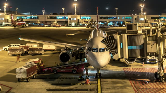 Time-Lapse: Arrival of Airplane to terminal Jetway Dock night