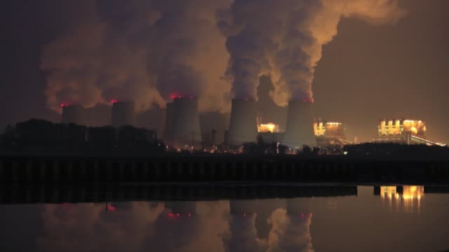 Timelapse as chimneys emit vapor at Jaenschwalde lignite power plant operated Vattenfall AB at dusk in Peitz Germany on Tuesday Dec 15 2015