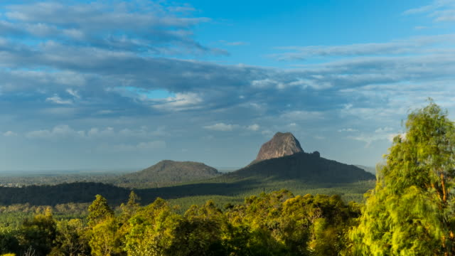 Timelapse at Glass House Mountains, Australia, with clouds moving fast and amazing views