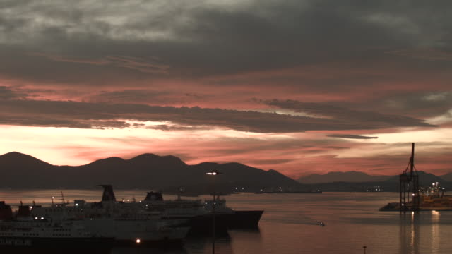 Time-lapse at harbour during the magic hour with clouds travelling