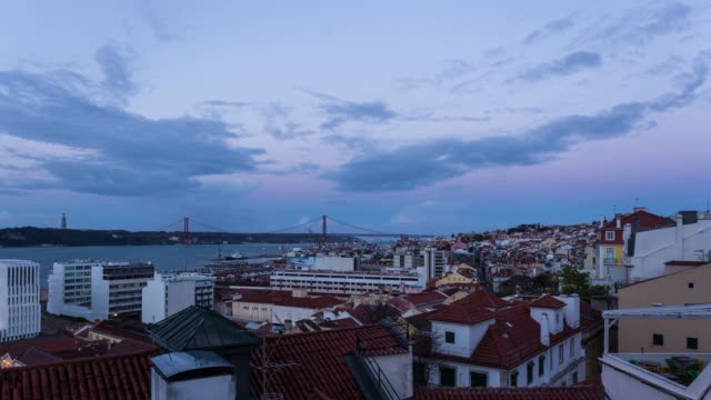 timelapse at sunrise of lisbon cityscape and the iconic ponte 25 de abril - ponte stock videos & royalty-free footage