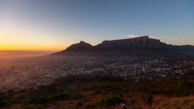 timelapse at sunrise of table mountain and cape town - cape town stock videos & royalty-free footage