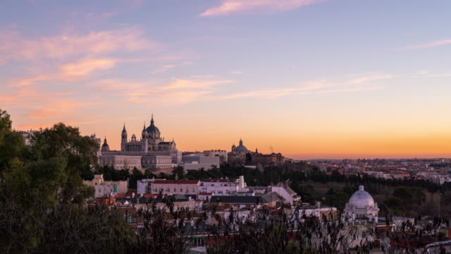 Timelapse at sunset of Almudena Cathedral and the Royal Palace in Madrid